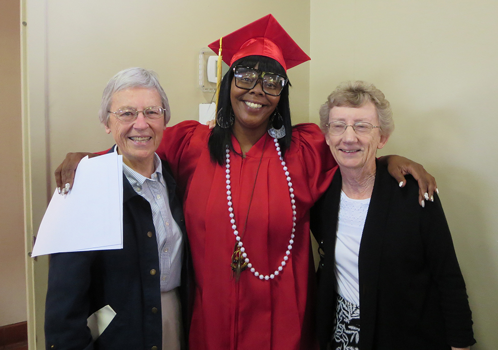 L-R: Sister Rosemary Delaney, NSLC graduate Cha'Shonn and Sister Cynthia Canning.